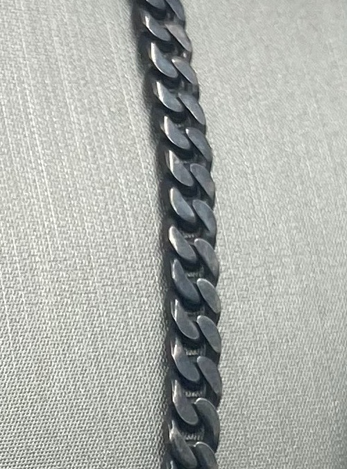 Oxidized sterling silver curb chain close up